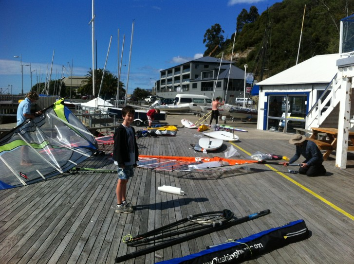 rigging up on the deck at Nelson Yacht Club - Tuesday evening windsurfing
